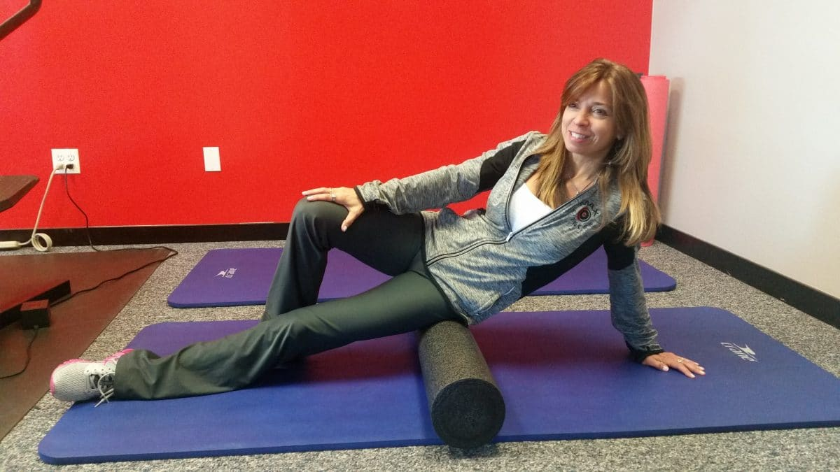 Trainer Lisa LaManna rolling piriformis muscle.